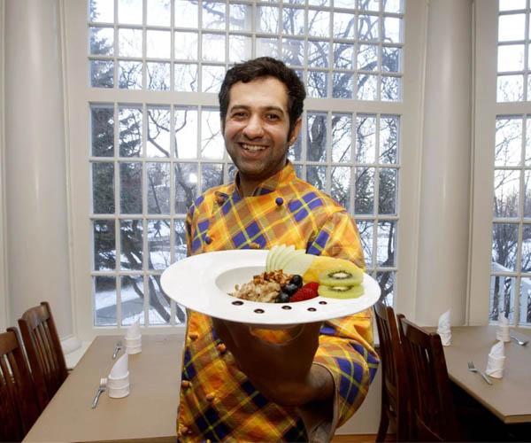 Salar Melli for Ward Metis councillor displays his gourmet brunch in news paper article photo